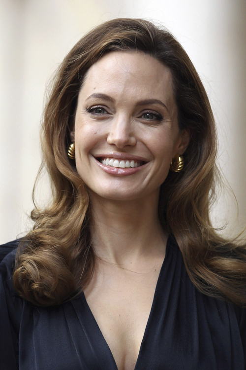U.S. actress and director Angelina Jolie arrives to Britain's Foreign Secretary William Hague ahead of a screening of her new film 'In the Land of Blood and Honey' at the Foreign Commonwealth Office in central London